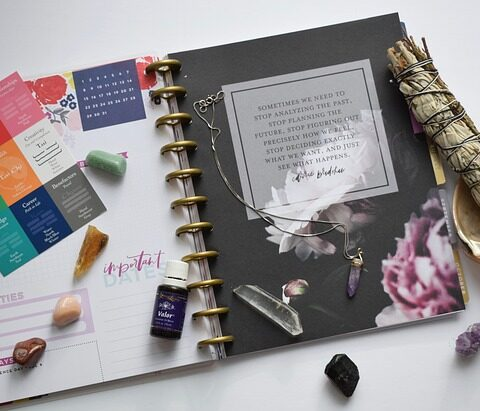 feng shui fixes are illustrated with a book and sage, crystal and bagua chart with an inspirational quote